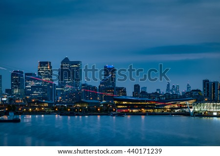 The London skyline at night with the skyscrapers from The City of London ( London's financial center) and the skyline of Canary Wharf ( Isle of Dogs, Docklands) illuminated