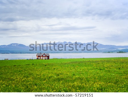 The lonely house on mountain lake in Norway - stock photo