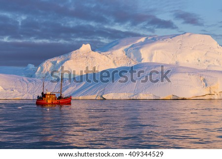 The lonely ship against ices. Travel on the scientific vessel among ices. Studying of a phenomenon of global warming. Ices and icebergs of unusual forms and colors. - stock photo