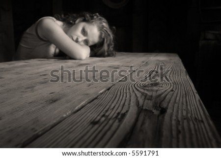 The lonely woman in a dark room - stock photo