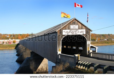 The longest wooden covered bridge in the world located in Hartland, New Brunwick, Canada in Autumn time - stock photo