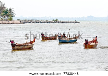 The Longtail boat of fisherman on the sea - stock photo