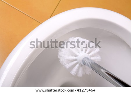 the look at cleaning toilet bowl - stock photo
