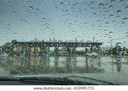 The Looking from inside the car, the atmosphere in the gas station when it rains.
