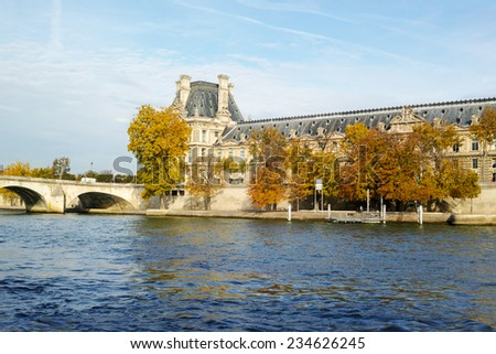 The Louvre across the Seine River in Paris France - stock photo