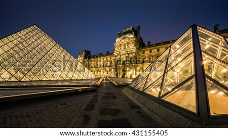 the louvre and pyramid  - stock photo