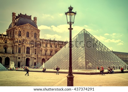 The Louvre in Paris on a sunny day. Vintage view. The Louvre in Paris old retro style.  - stock photo