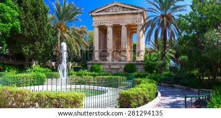 The Lower Barakka Gardens is a garden in Valletta, and it is twinned with the Upper Barrakka Gardens. It offers a magnificent view of the Grand Harbor and the Breakwater. - stock photo