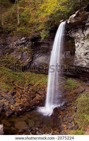 The lower falls of hill creek in West Virginia.Taken at near peak autumn colors. - stock photo
