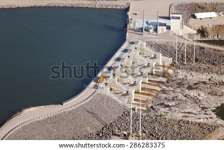 The lower hydroelectric dam on the Snake River near Idaho Falls, Idaho, USA.  This is a public hydroelectric plant owned by a Municipality. - stock photo
