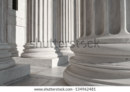 The lower part of the massive columns at the US Supreme Court Building. - stock photo