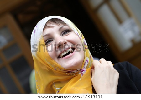 The lucky girl in yellow headscarf, outdoor - stock photo