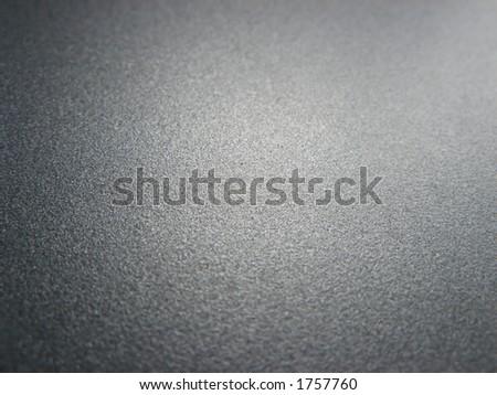 The lustrous paint of a laptop. - stock photo