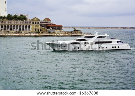 The luxurious boat returned to port because of bad weather.
