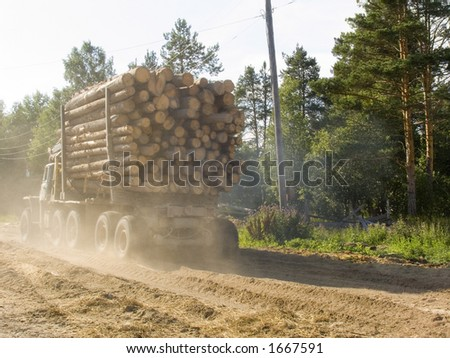 The machine for transportation of a wood on a country road - stock photo