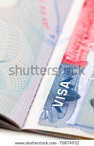 the macro shot of a U.S. visa on passport page - stock photo
