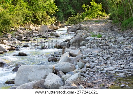 the mad rush of water down the creek - stock photo