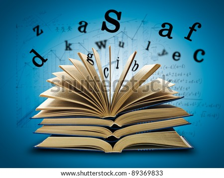 The Magic Book and the letters on a dark background with formula. Education concept - stock photo