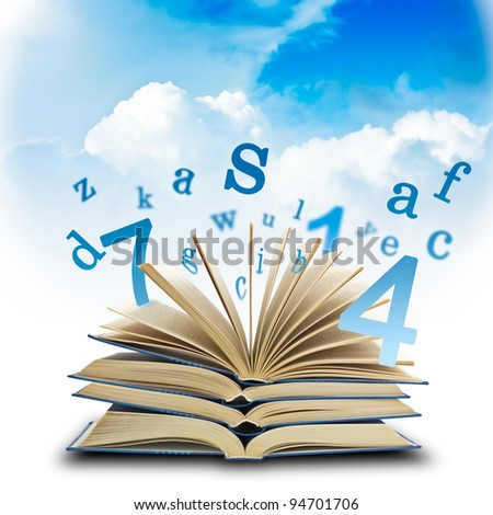 The Magic Book and the letters on a sky background. Education concep - stock photo