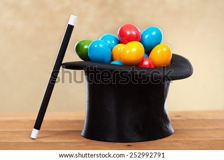 The magic of easter - colorful eggs in magician hats on golden background- shallow depth of field - stock photo
