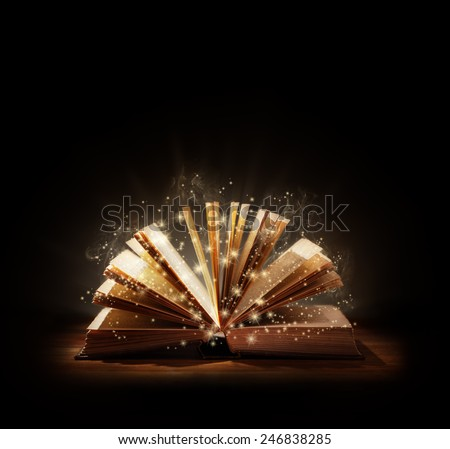 The magic of reading, storytelling and education or bible and religion, Black background space above for text message or copy. - stock photo