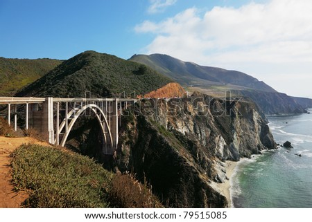 The magnificent bridge on coastal highway of rocky and steep Pacific coast USA - stock photo