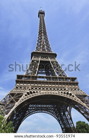 The magnificent Eiffel Tower in Paris on a summer day - stock photo