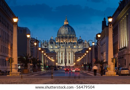 The magnificent evening view of St. Peter's Basilica in Rome by the Via della Conciliazione - stock photo