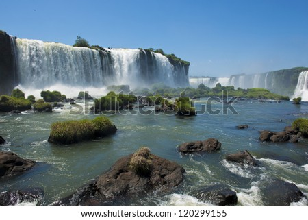 the magnificent garganta del diablo at the iguazu falls, one of the seven natural wonders of the world - stock photo