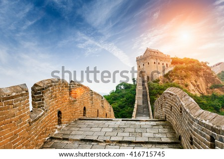 The magnificent Great Wall of China in the sunset - stock photo