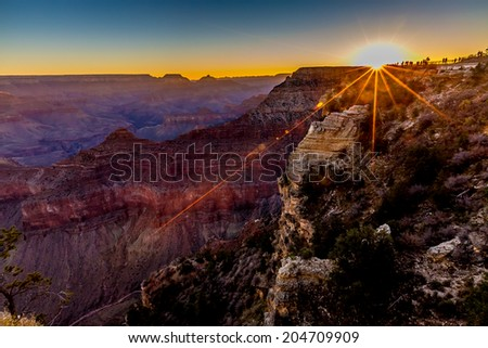 The Magnificent Multi-colored Grand Canyon at the Exact Moment of Sunrise, in Arizona.  South Rim. - stock photo