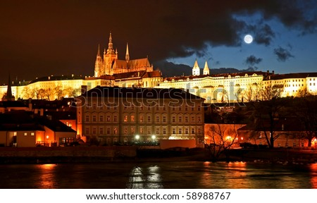 The magnificent Prague Castle at night along the River Vltava