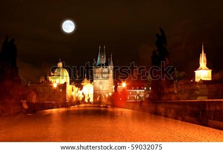 The magnificent Prague Castle at night along the River Vltava - stock photo