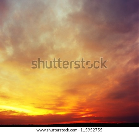 The magnificent sky and clouds in last beams of the sun. - stock photo
