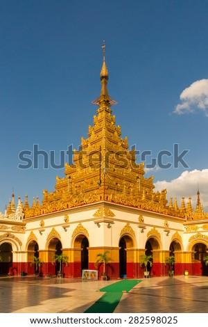 The Mahamuni Buddha Temple, an important buddhist pilgrimage site in Mandalay, Myanmar - stock photo