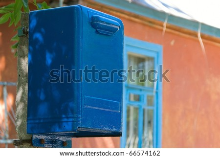 The mail box near the house waits the correspondence
