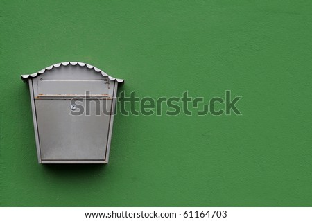 The mail box on the green wall - stock photo