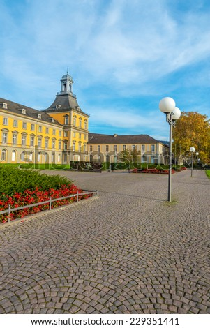 The main building of Bonn University, with cobblestones in the foreground. - stock photo