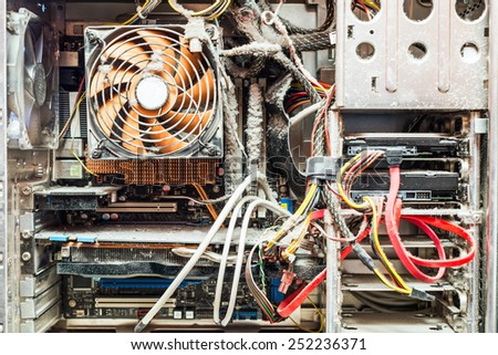 The main components of the outdated, dusty and non-working computer - stock photo