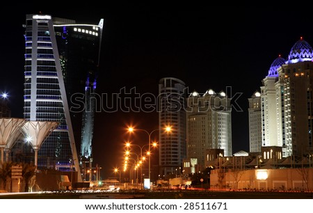 The main five-star hotels area of Doha, in West Bay, pictured at night. - stock photo