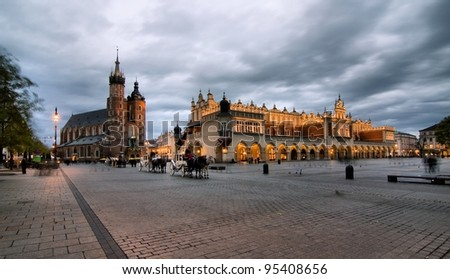 The Main Market Square in Cracow  is the most important square of the Old Town in Cracow, Poland. In the background is St. Mary's Basilica. - stock photo