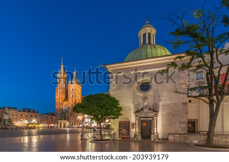 The Main Market Square in Krakow with Church of St. Adalbert (Wojciech) and St. Mary's Basilica, Poland - stock photo