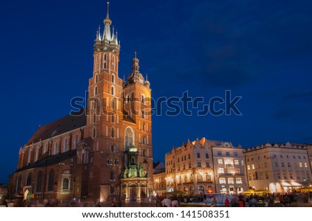 The Main Market Square in Krakow with St. Mary's Basilica, Poland - stock photo