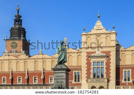The main market square (Rynek Glowny) in Krakow in Poland. The statue is of Adam Mickiewicz.  - stock photo