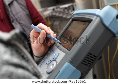 The maintenance of telecom line on a server room - stock photo