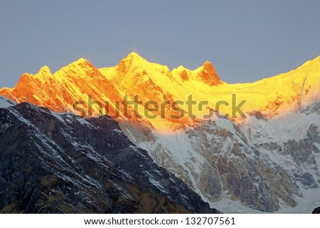 The majestic  Annapurna range of the himalayas at first light of sunrise - stock photo