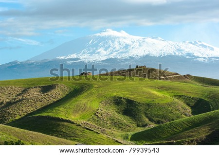 the majestic Etna dominates the rolling hills of the hinterland of Sicily - stock photo