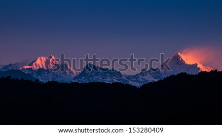 The majestic Kanchenjunga range of the himalayas at first light of sunrise at Sikkim , India - stock photo