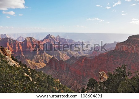The majestic landscape of the Grand Canyon. Late-afternoon mist rises from the bottom of the canyon