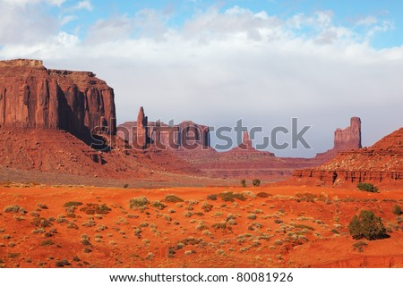 "The majestic Monument Valley. Famous bright orange sandstone rock ""Mittens"" - stock photo"